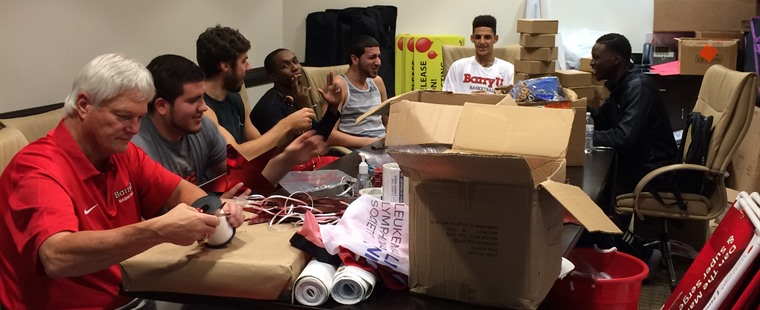 Serving Time: Men's Hoops Helps Out at Leukemia Society