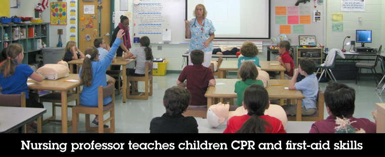 Nursing professor teaches children CPR and first-aid skills