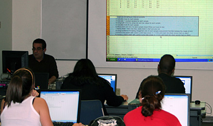 Prof. Ricardo Jimenez explains the use of a spreadsheet application for his Introduction to Computers class