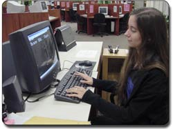 Student using the computer in the Library