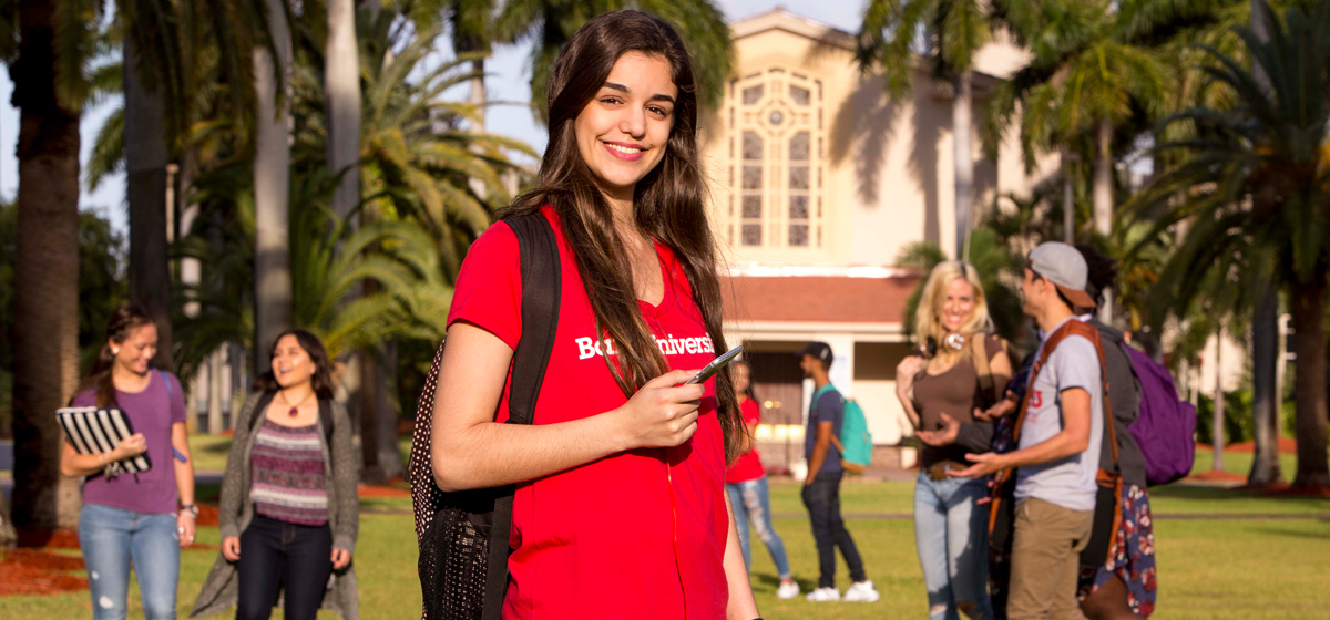 Student standing in front of Cor Jesu Chapel