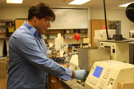 Daniel Campos (Class of 2011) studies atomic absorption spectrometry.