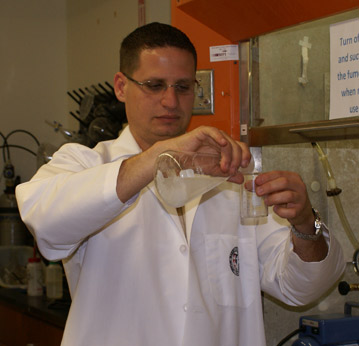 Nathan Gonzalez preparing a sample for HPLC analysis in the Fisher research group.