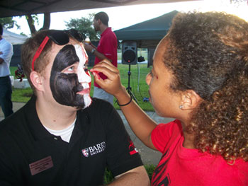 Barry Student getting his face painted at a University Event